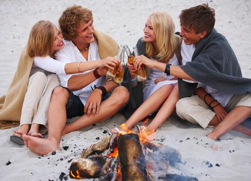 bonfire and teenagers. shutterstock