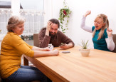 the family play cards. shutterstock