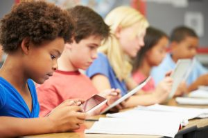 pupils and their tablets. shutterstock