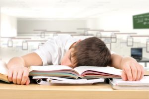sleeping in the classroom. shutterstock